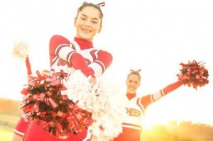 Group of cheerleaders performing outdoors at high school camp
